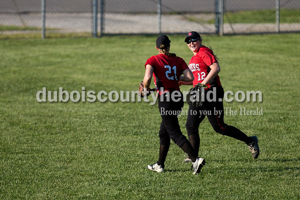 Southridge's Misty Merter, left, and Mallory Peter ran off the outfield at the end of an inning during Monday evening's game against Northeast Dubois in Dubois. The Jeeps won 7-6. Ariana van den Akker/The Herald