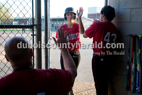 Southridge's Kassidy Mundy got high fives after batting during Monday evening's game against Northeast Dubois in Dubois. The Jeeps won 7-6. Ariana van den Akker/The Herald
