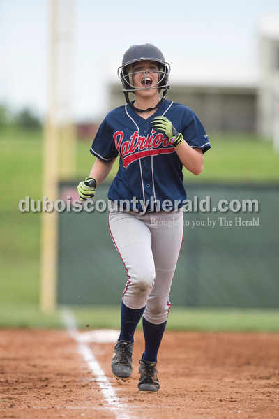 Heritage Hills' Maddie Fuller ran home as Lauren Caswell hit a home run during Friday's game at Southridge High School in Huntingburg. The Patriots beat the Raiders 9-3. Sarah Ann Jump/The Herald
