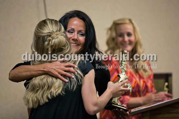 Jill Wigand hugged Jasper High School senior, Bryce Blue, during the high school dance team awards banquet at the end of their season on April 10 at the high school in Jasper. Jill and her co-coach and daughter, Jordan Beach of Jasper, right, gave out awards to the girls at  the banquet. Jordan also presented her mother with an award for 10 years of coaching the high school dance team. Jill Wigand was the first one to bring a dance team to Jasper Middle School 15 years ago, and to Jasper High School 10 years ago.