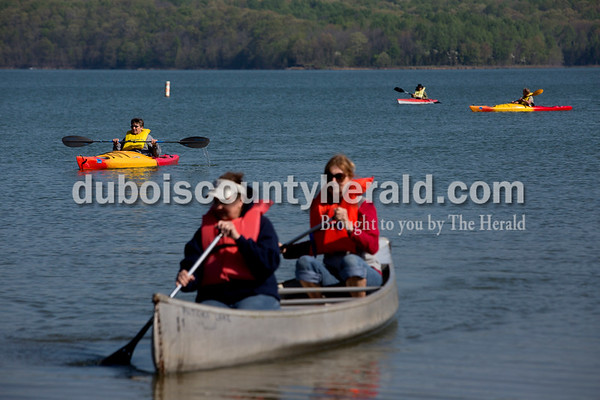 Ariana van den Akker/The Herald Barbara Beckman of Lanesville, left, kayaked as Marilyn Fischer of Boonville, center, and her sister Paula Janoski of Evansville canoed during a class on Sunday morning as part of the Women's Wilderness Weekend event at Patoka Reservoir.