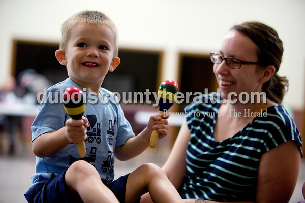 Ariana van den Akker/The Herald Everett Rucker of Jasper, 2, played maracas while his mother Misty watched him during a Tuneful Tots class on Tuesday evening at the family life center at the Church of the Nazarene in Huntingburg. The class for toddlers and their caregivers blends music, movement, storytelling and play.
