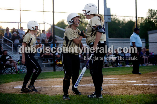 Jasper's Olivia Knies, right, congratulated Nicolette Eckert, center, after she scored during Thursday night's game against Boonville in Jasper. The Wildcats won 11-3. Ariana van den Akker/The Herald