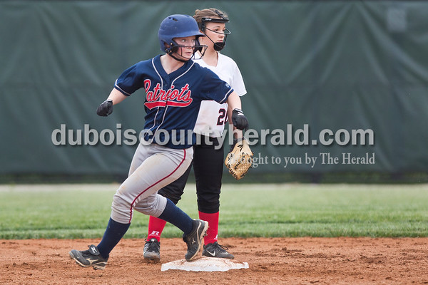 Heritage Hills' Rebeka Mercker looked back as she made it to second base during Friday's game at Southridge High School in Huntingburg. The Patriots beat the Raiders 9-3. Sarah Ann Jump/The Herald