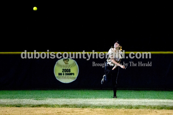 Jasper's Katelyn Hedinger threw the ball to the infield after catching a fly ball during Thursday night's game against Boonville in Jasper. The Wildcats won 11-3. Ariana van den Akker/The Herald