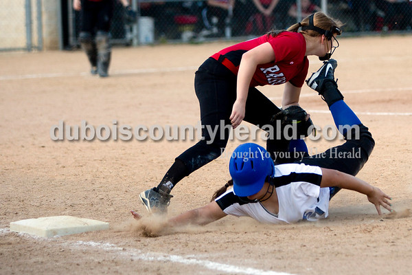 Southridge's Amanda Brewer tagged Northeast Dubois' Camryn Stemle out at first during Monday evening's game in Dubois. The Jeeps won 7-6. Ariana van den Akker/The Herald