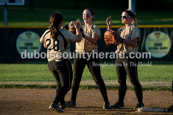 Jasper's Paige Werner, center, and Nicolette Eckert greeted Olivia Burger as she was announced before Thursday night's game against Boonville in Jasper. The Wildcats won 11-3. Ariana van den Akker/The Herald