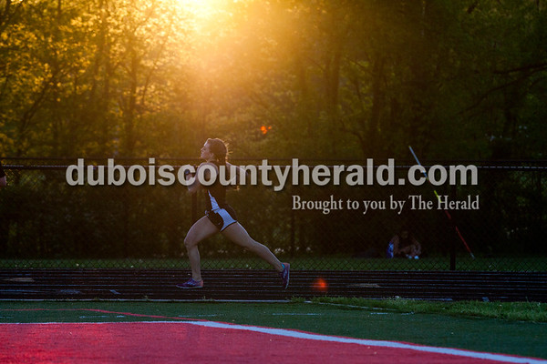 Southridge's Lauren Meyer rounded the corner of the track in the 800-meter run during Thursday's Southridge Invitational in Huntingburg. Meyer placed second in the run with a time of 2:30.2. Heritage Hills picked up second place in the invitational behind Perry Central, while the host Southridge claimed third and Northeast Dubois took seventh of eight teams.     Alisha Jucevic/The Herald