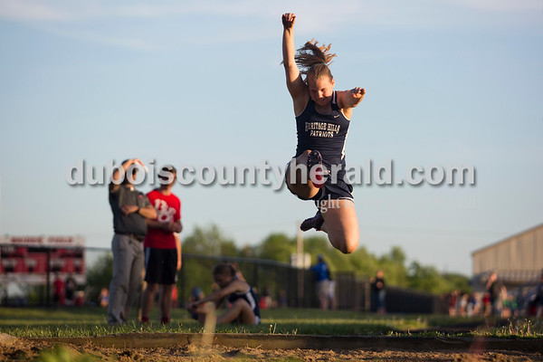 Heritage Hills' JayLynn Yeager leapt into the air during the long jump event at Thursday's Southridge Invitational in Huntingburg. Heritage Hills picked up second place in the invitational behind Perry Central, while the host Southridge claimed third and Northeast Dubois took seventh of eight teams.   Alisha Jucevic/The Herald