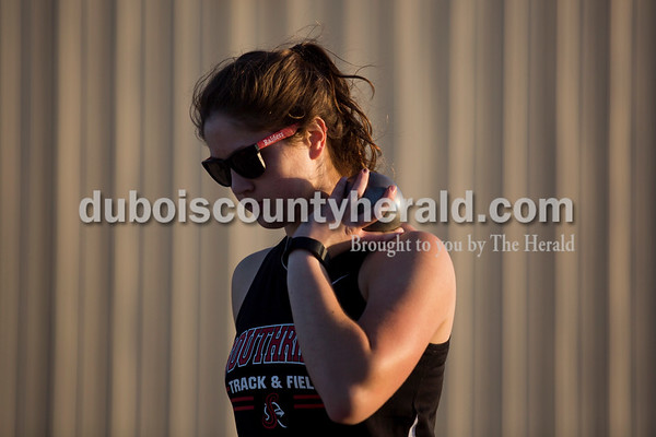 Southridge's Sydney Altmeyer prepared for a throw in the shot put event at Thursday's Southridge Invitational in Huntingburg. Altmeyer placed first in the event.   Alisha Jucevic/The Herald