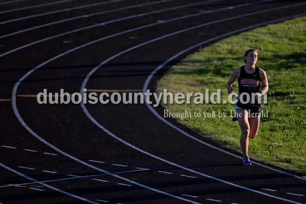 Southridge's Lauren Meyer rounded the track during the 1,600-meter run during Thursday's Southridge Invitational in Huntingburg. Meyer placed first in the 1,600-meter event with a time of 5:45.3. Heritage Hills picked up second place in the invitational behind Perry Central, while the host Southridge claimed third and Northeast Dubois took seventh of eight teams.   Alisha Jucevic/The Herald
