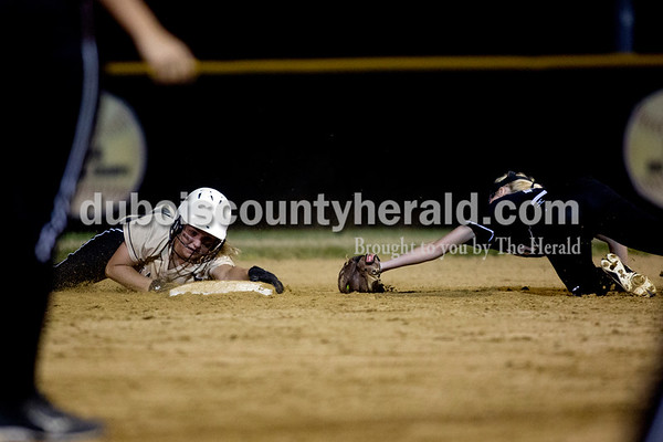 Jasper's Nicolette Eckert grabbed onto second base as Boonville's Megan Ripperdan tried to tag her during Thursday night's game in Jasper. The Wildcats won 11-3. Ariana van den Akker/The Herald