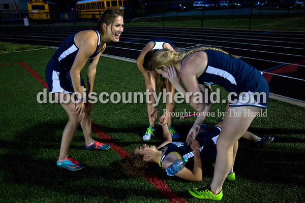 Heritage Hills' Kayla Blake, left, laughed with her teammates after they won the 1,600-meter relay at the end of Thursday's Southridge Invitational in Huntingburg. Heritage Hills picked up second place in the invitational behind Perry Central, while the host Southridge claimed third and Northeast Dubois took seventh of eight teams.   Alisha Jucevic/The Herald