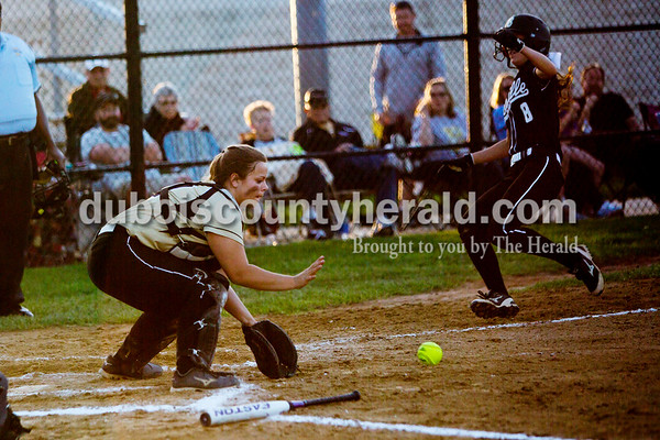 Jasper's Lindsay Mehringer scooped up the ball to tag Boonville's Taylor Miles out at home during Thursday night's game in Jasper. The Wildcats won 11-3. Ariana van den Akker/The Herald