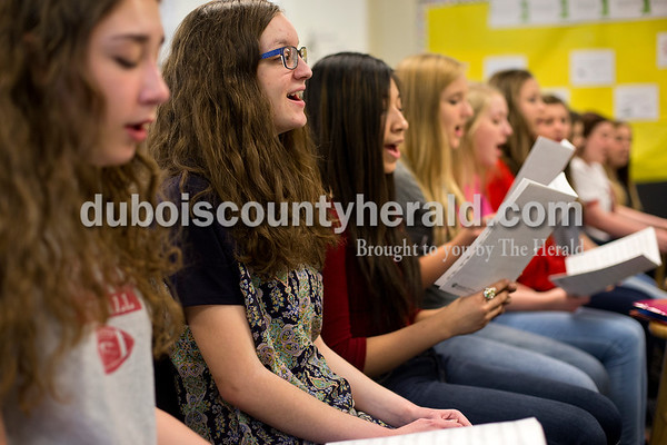 Dave Weatherwax/The Herald Heritage Hills High School junior August Tuggle, second from left, practice a song with her choir classmates last week. Since August is visually impaired, she can't use sheet music to learn and sing the songs.