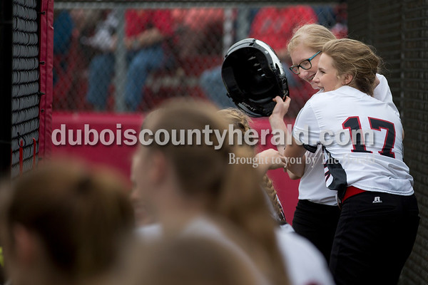 Southridge's Peyton Nalley, right, hugged Megan Buechler after a run  during Friday's game at Southridge High School in Huntingburg. The Patriots beat the Raiders 9-3. Sarah Ann Jump/The Herald