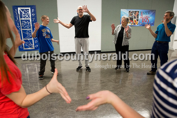 Sarah Ann Jump/The Herald Connor Krips of Jasper, 13, left, Michael Bonifer of Los Angeles, Michael's mother Fern Bonifer of Ireland and Brian Meyer of Jasper waved their arms as Michael taught the group a game during an improvisation workshop at Jasper Arts Center on Saturday morning.