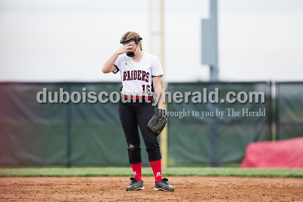 Southridge's Amanda Brewer paused between batters as she played first base during the top of the seventh inning during Friday's game at Southridge High School in Huntingburg. The Patriots beat the Raiders 9-3. Sarah Ann Jump/The Herald
