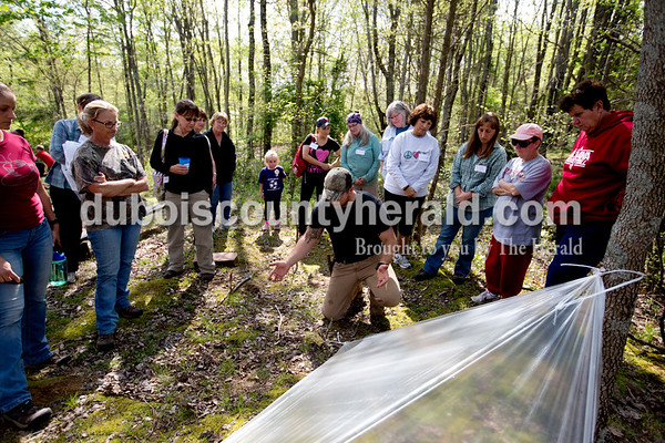 Ariana van den Akker/The Herald Logan Fromme of Jasper demonstrated how to properly stake a shelter using two sticks in an x shape while teaching a survival skills class on Saturday during the Women's Wilderness Weekend event at Patoka Reservoir.