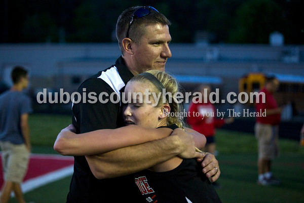 Southridge's Cassie Lamb hugged her coach Ted O'Brien after finishing the 3,200-meter run during Thursday's Southridge Invitational in Huntingburg. Lamb placed fourth in the run with a time of 13:42.3. Heritage Hills picked up second place in the invitational behind Perry Central, while the host Southridge claimed third and Northeast Dubois took seventh of eight teams.   Alisha Jucevic/The Herald