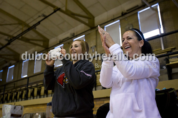 """Jill Wigand clapped for the dancers as her and her daughter and co-coach Jordan Beach, of Jasper, watched the Jasper High School dance team run through their hip-hop routine on Jan. 22 at Cabby O'Neil Gymnasium in Jasper. Jordan started coaching with her mother five years ago and now choreographs all of the routines for their team. Parents attended this particular practice to watch the girl's routine and learn when in the routine they could cheer and give the girls extra support. """"It's kind of like band,"""" Jill explained. """"You want to cheer not just in the parts that are great, but when the girls are at there lowest and when their energy is about to drop."""""""