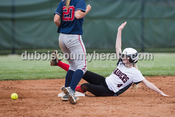 Southridge's Megan Buechler slid safely into second base during Friday's game at Southridge High School in Huntingburg. The Patriots beat the Raiders 9-3. Sarah Ann Jump/The Herald