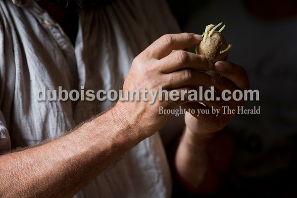 Sarah Ann Jump/The Herald Lead farmer Bob Zimmerman of Lincoln City showed students a potato and talked about how they grow during a field trip to the Living Historical Farm at Lincoln Boyhood National Memorial in Lincoln City.