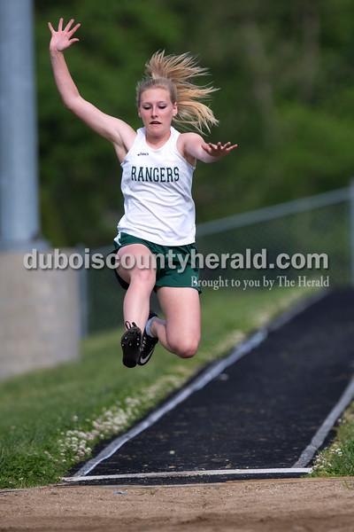 Forest Park's Hannah Borden jumped forward in the long jump during the Southridge and Forest Park dual meet on Monday evening in Ferdinand.   Alisha Jucevic/The Herald