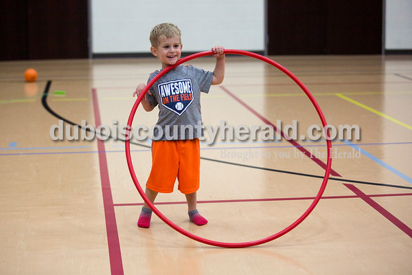 Zayden Frick of Ferdinand, 3, played with a hoola hoop during the Tri-County YMCA annual Healthy Kids' Day on Saturday in Ferdinand.   Alisha Jucevic/The Herald