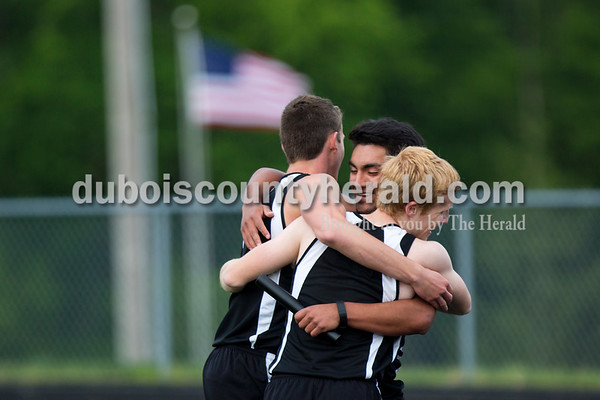 Southridge's Jayden Montgomery, left, and Kru Allen, right, congratulated the last leg of their 1,600-meter relay team, Jonnathan Macias, center, at the end of the Southridge and Forest Park dual meet on Monday evening in Ferdinand. Southridge (69) boys took first ahead of Forest Park (62) and Forest Park (68) girls took first ahead of Southridge (64).    Alisha Jucevic/The Herald