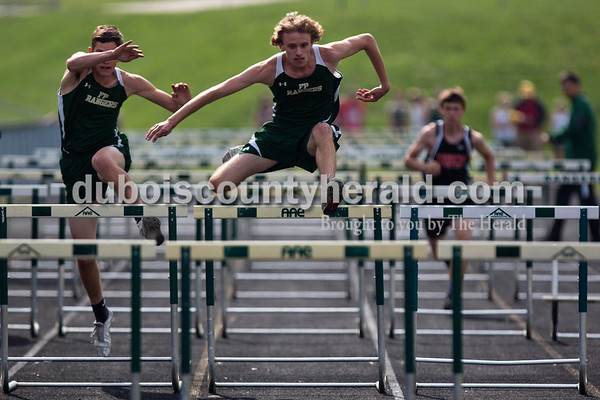 Forest Park's Zach Lueken, center, leapt over the hurdles during the 110-meter hurdles in the Southridge and Forest Park dual meet on Monday evening in Ferdinand.   Alisha Jucevic/The Herald