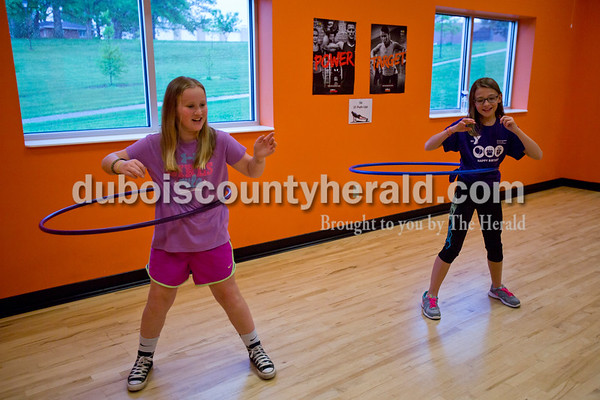Ilie Nicholson,10, left, hoola-hooped with her friend, Braelyn Houchin, both of Huntiungburg, 10, during the Tri-County YMCA annual Healthy Kids' Day on Saturday in Ferdinand. The free event provided activities that focused on a healthy spirit, mind and body. Events throughout the day included yoga, healthy bingo, story time, nutritious snacks, a bouncy house and much more.   Alisha Jucevic/The Herald