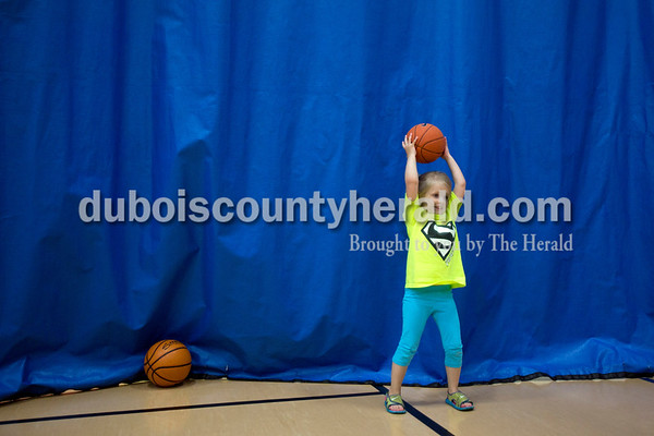 Aylnn Gogel of Ferdinand, 3, played basketball with her brother, Ryles, 7, during the Tri-County YMCA annual Healthy Kids' Day on Saturday in Ferdinand.  Alisha Jucevic/The Herald