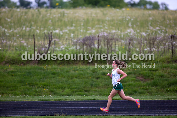 Forest Park's Elizabeth Miller ran in the 3,200-meter run during the Southridge and Forest Park dual meet on Monday evening in Ferdinand.  Alisha Jucevic/The Herald