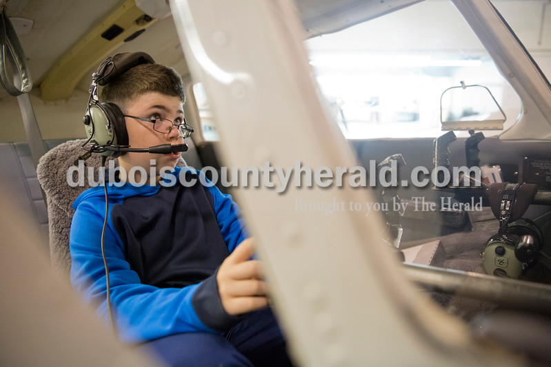 Sarah Ann Jump/The Herald<br /> Kanton Dearwester of Loogootee, 9, pretended to fly a plane during the Radio Control Aviation Appreciation Fly In at Huntingburg Airport on Saturday. The event was held in an airplane hangar due to windy weather.