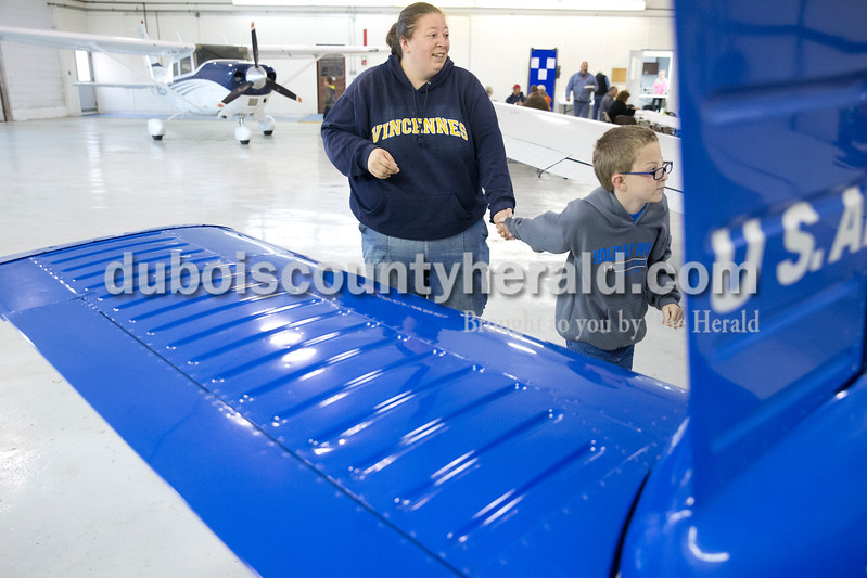 Sarah Ann Jump/The Herald<br /> Amy Beck of Jasper and her son Briar, 6, looked around at airplanes during the Radio Control Aviation Appreciation Fly In at Huntingburg Airport on Saturday.