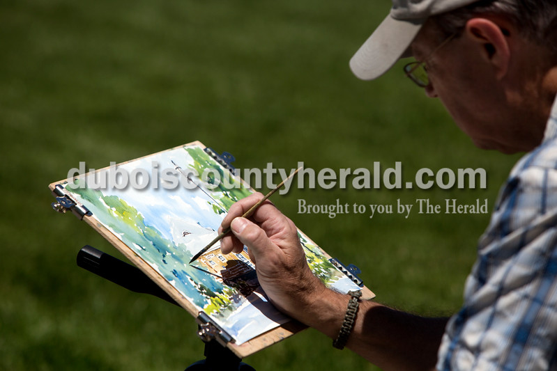 "Ariana van den Akker/The Herald<br /> Gary Beazley of St. Louis worked on a watercolor painting near the Jasper Train Depot as part of the Plein Air competition through the Jasper Arts Center on Friday afternoon. Beazley has been doing plein air competitions for about 5 years and said this is the furthest one from St. Louis that he's participated in. ""I like painting outdoors because it makes you braver,"" Beazley said while talking about why he enjoys plein air painting."