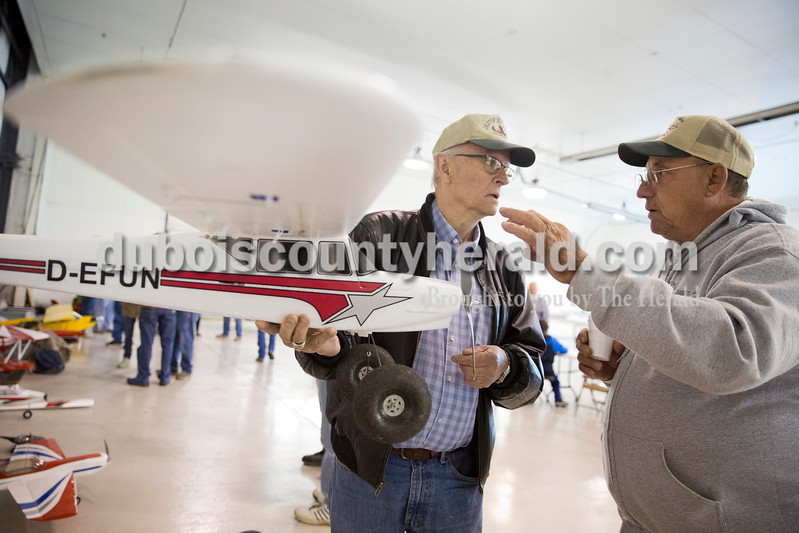 Sarah Ann Jump/The Herald<br /> Doug Lukemeyer of Jasper, left, and Larry Knepp of Loogootee talked about planes during the Radio Control Aviation Appreciation Fly In at Huntingburg Airport on Saturday.