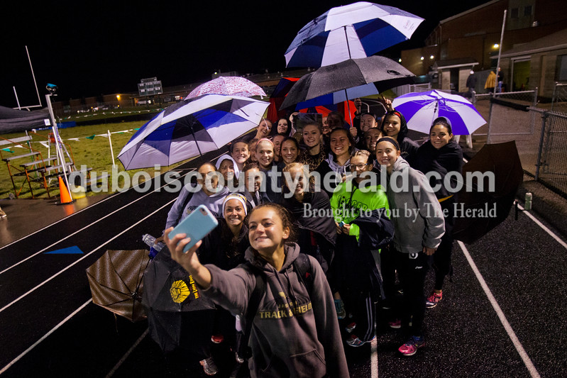 Jasper's Tara Cassidy took a team selfie after Tuesday's IHSAA girls track sectional at Perry Central. Jasper took first place in the 10-team meet.<br /> <br /> Alisha Jucevic/The Herald
