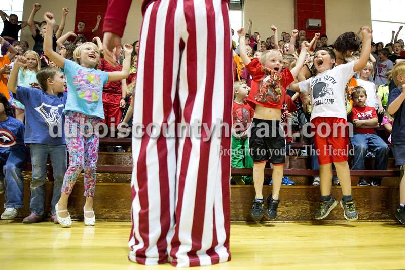 "Sarah Ann Jump/The Herald<br /> Students chanted ""Go IU"" as teacher Kim Wirthwein cheered with them during Holland Elementary's Riley Day celebration on Friday. Wirthwein, a Kentucky fan, dressed as an Indiana University fan for the day as one of the fundraising incentives."