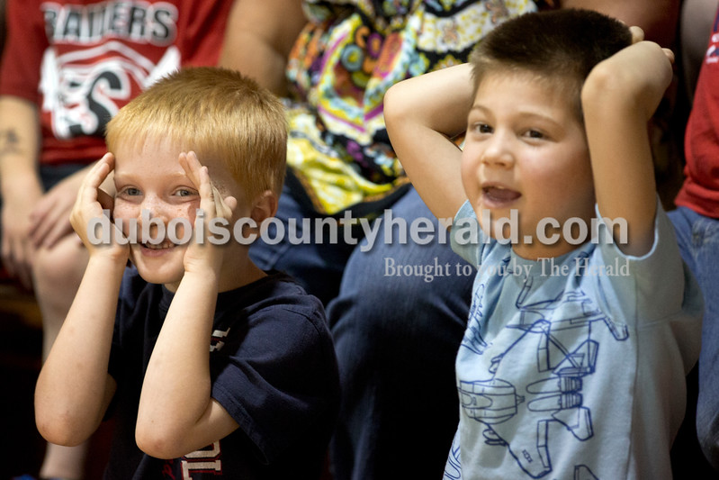 Sarah Ann Jump/The Herald<br /> Holland Elementary kindergarteners Bryce Luttrell, left, and Jaden Owens watched as teachers ate anchovies during the school's Riley Day celebration on Friday.
