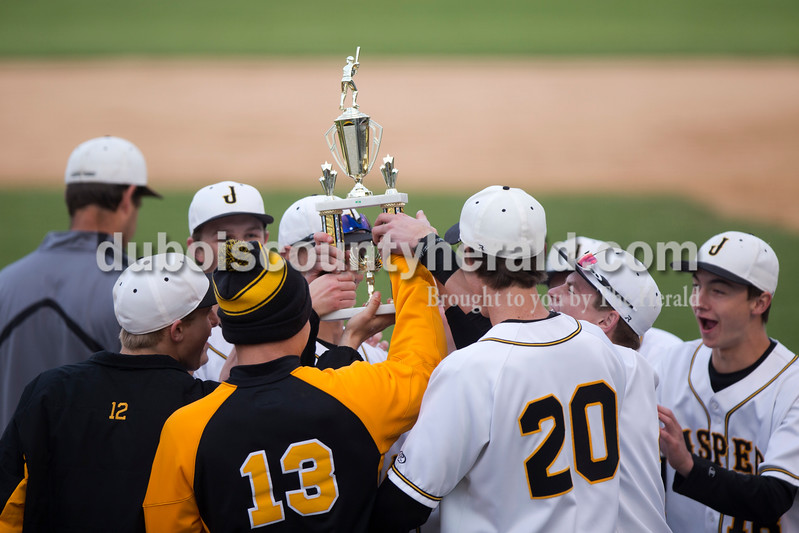 The Jasper baseball team was presented with a trophy after winning the championship game of the Indiana Baseball Hall of Fame Classic at Ruxer Field in Jasper on Saturday. Jasper beat Lake Central 10-1. Sarah Ann Jump/The Herald