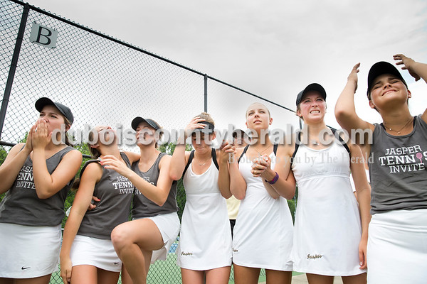 Jasper's Mackenzie Cooley, left, Aubrey Williams, Kathleen Messmer, Sarah Monesmith, Caroline Theil, Maria Lueken and Maggie Getzin reacted as opponent Providence scored a point during a doubles match when Jasper was one win away from securing the semistate title during the girls tennis semistate championship at Jasper High School on Saturday. Jasper defeated Providence 3-2. Sarah Ann Jump/The Herald