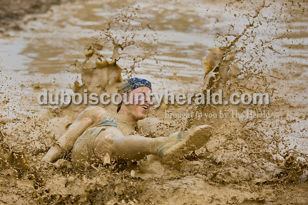 Sarah Ann Jump/The Herald Jasper High School senior Ben Wendholt fell in the mud during the school's annual mud volleyball tournament on Wednesday.