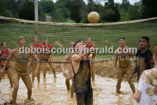 Sarah Ann Jump/The Herald Jasper High School senior Austin Horsting hit the ball during the championship game of school's annual mud volleyball tournament on Wednesday.