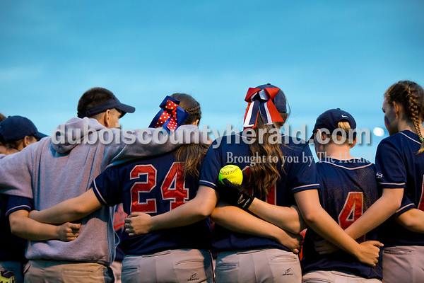 The Heritage Hills softball team and head coach Joe Asbury, left, huddled after Thursday's Class 3A sectional championship game in Boonville. The Heritage Hills Patriots lost to the Boonville Pioneers 8-2. Sarah Ann Jump/The Herald
