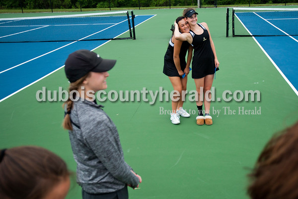 Jasper's Jillian Seger, left, and Sarah Monesmith hugged for a photo after the tennis regional championship against Paoli on Wednesday evening at Jasper High School. The Wildcats won the championship and will move on to semistate this Saturday.  Alisha Jucevic/The Herald