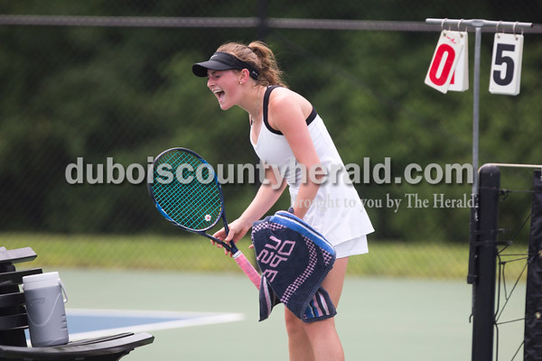 "Jasper's Sarah Monesmith yelled ""Go Wildcats"" after her win over Providence's Heidi Popson during the girls tennis semistate championship at Jasper High School on Saturday. Jasper defeated Providence 3-2. Sarah Ann Jump/The Herald"
