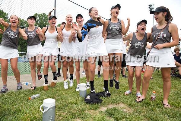 The Jasper girls tennis team reacted as Emma and Olivia Yarbrough won their doubles match, securing the semistate title for Jasper, during the girls tennis semistate championship at Jasper High School on Saturday. Jasper defeated Providence 3-2. Sarah Ann Jump/The Herald