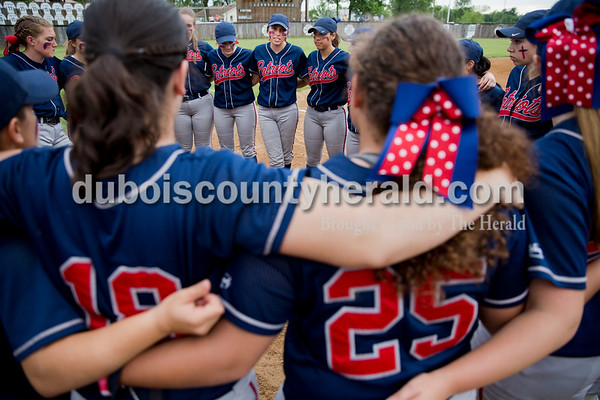Heritage Hills' Haley Begle, center, gave advice during a team huddle before Thursday's Class 3A sectional championship game in Boonville. The Heritage Hills Patriots lost to the Boonville Pioneers 8-2. Sarah Ann Jump/The Herald